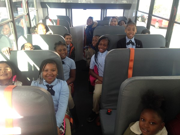Eighteen students make up the team in grades 1-4, here they are aboard the bus at DLEACS.