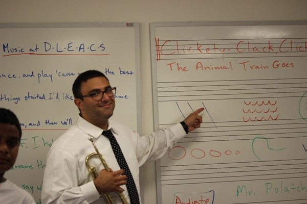 Mr. Polatcheck ( Mr. P. ) teaches students to read music.