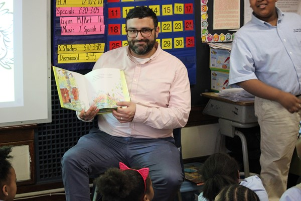 Mr. P. reads to third grade in Mrs. Seriosa's class