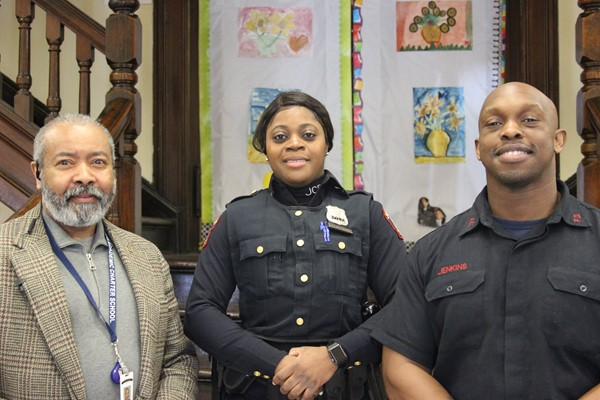 Principal Brewer with Jersey City's finest! JCPD Officer Putnam and JC Fire Fighter Jenkins